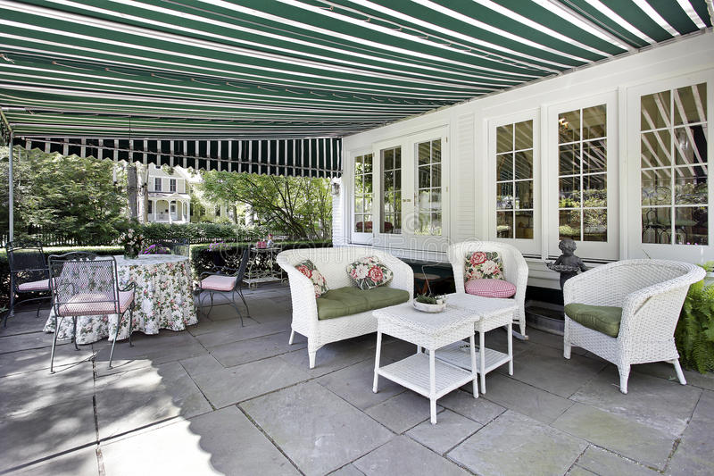 Patio with green awning royalty free stock photos