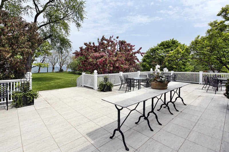 Patio with lake view royalty free stock image