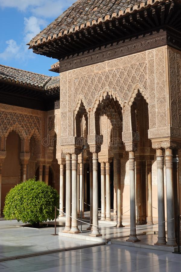 Patio of the Lions at Nasrid palace of the Alhambra in Granada, Andalusia. Wall decorations with arabesque ornaments at the Lions Palace court of the Nasrid royalty free stock images