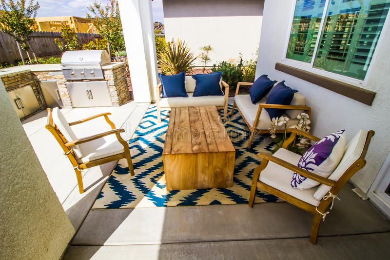 Patio Of Modern Home With BBQ And Sitting Area royalty free stock photography