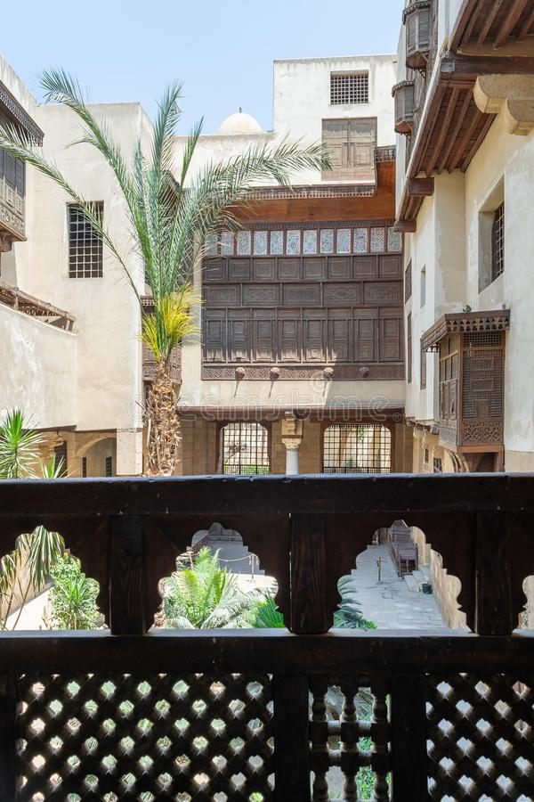Patio of ottoman era Beit El Sehemy historic building framed by wooden balustrade, Cairo, Egypt. Patio of ottoman era Beit El Sehemy historic building framed by stock photos