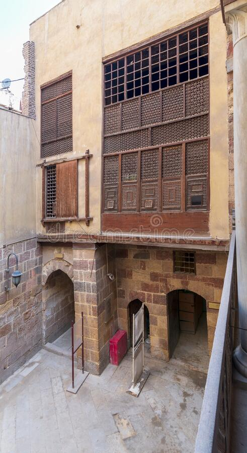 Patio of ottoman historic Waseela Hanem House with wooden oriel windows royalty free stock photo