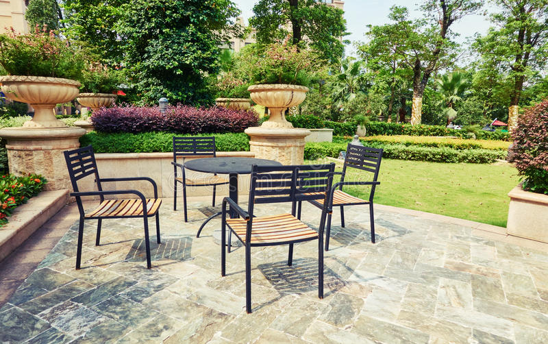 outdoor backyard patio in landscaping garden with furniture royalty free stock photos
