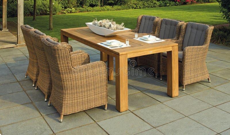 Patio table in garden stock photo