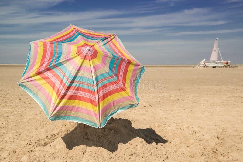 Patio Umbrella on Sand royalty free stock photos