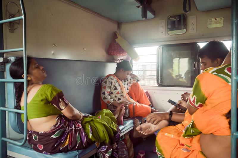 Patna India May 2019 - Tired exhausted woman Passengers falling asleep in a long ride, sitting in their seat and taking a nap. Inside a train compartment while royalty free stock photography