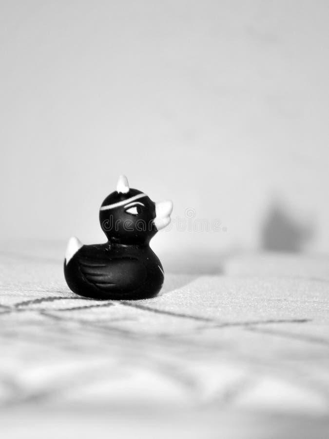 Pato de goma negro imagenes de archivo