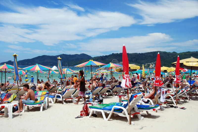Patong, Thailand: Famed Patong Beach. With its pure white sand and azure blue seas the beach at Patong on Phuket Island in Thailand draws visitors from all over royalty free stock photos