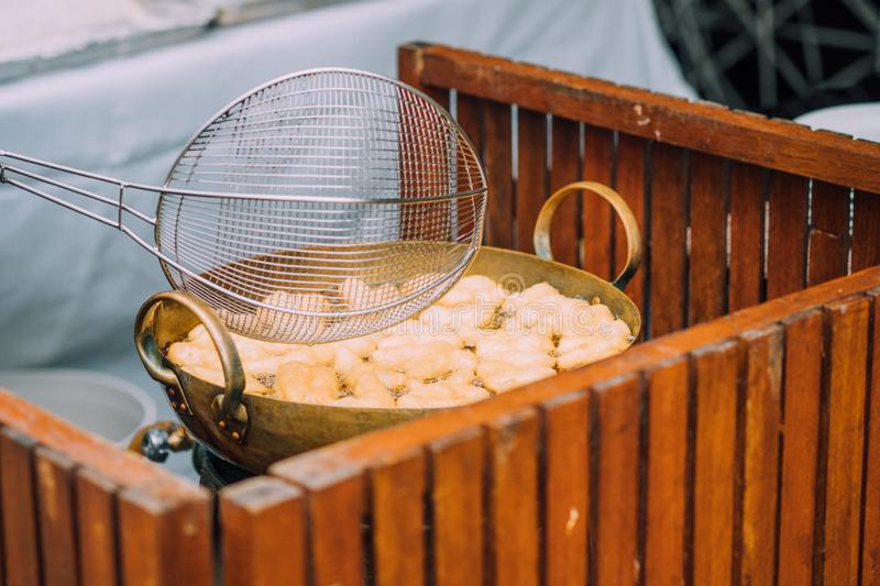Patongko - Frying deep fried dough stick in pan. Sell in morning market of Thailand royalty free stock photos