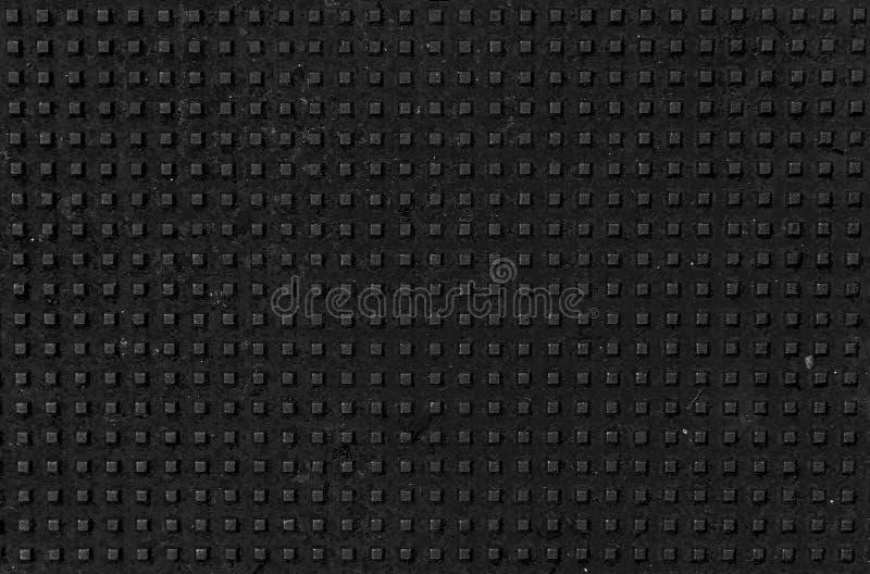 Patrón de agujeros con un diseño metálico cuadrado imágenes de archivo libres de regalías