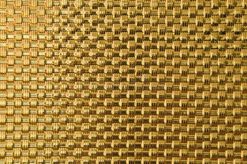Patrón de centelleo de barras de metal trenzado dorado imagen de archivo libre de regalías