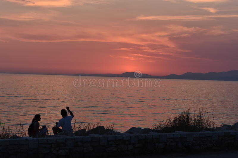 Patra, beautifull sunset with cloudy sky stock photography