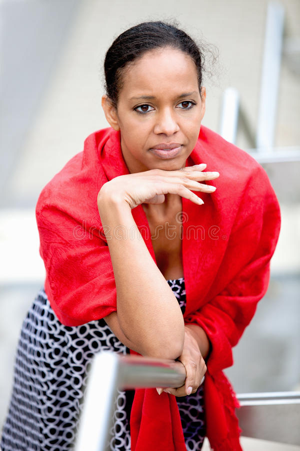Patricia. A young dark-skinned lady looks thoughtfully into the distance royalty free stock photos