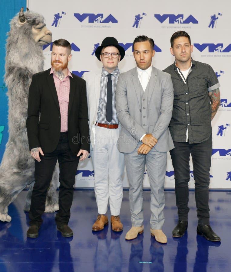 Patrick Stump, Pete Wentz, Joe Trohman et Andy Hurley de Fall Out Boy photographie stock libre de droits