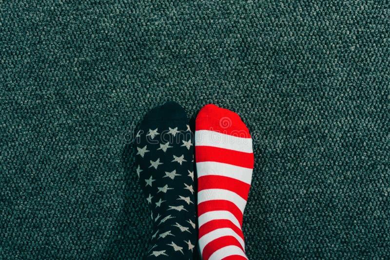 Patriotic adult male wearing USA flag socks stock image
