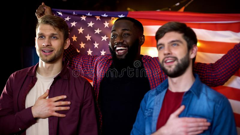 Patriotic american fans cheering for team, singing anthem and waving flag in pub. Stock photo royalty free stock photos
