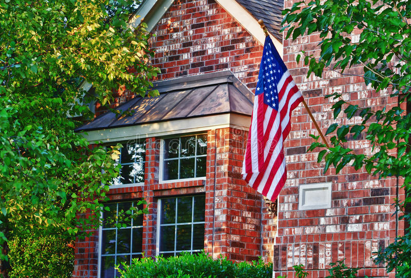 Patriotic American flag. In front of southern home royalty free stock photography