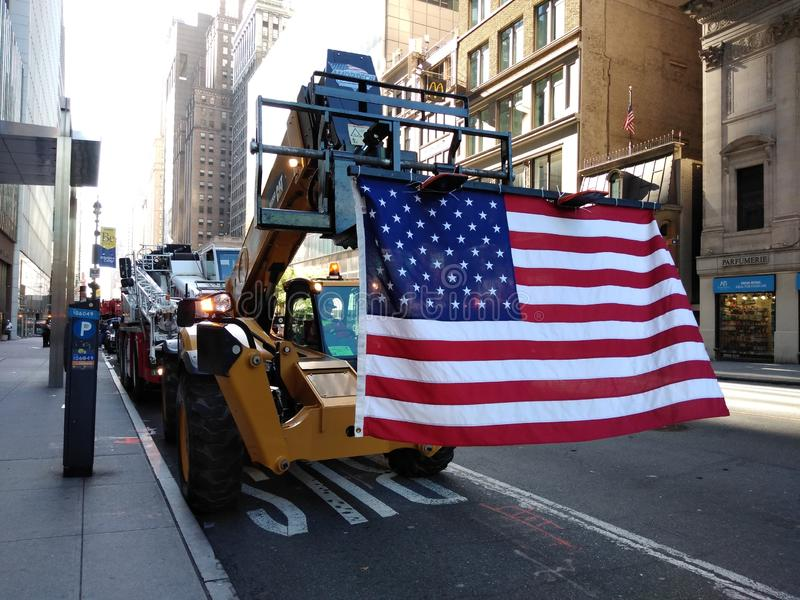 American Flag On A Forklift Truck, Labor Day Parade, NYC, NY, USA royalty free stock photos