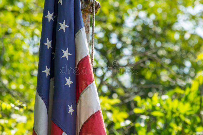 American Flag Bokeh. Patriotic American flag on summer day with green background bokeh stock photography