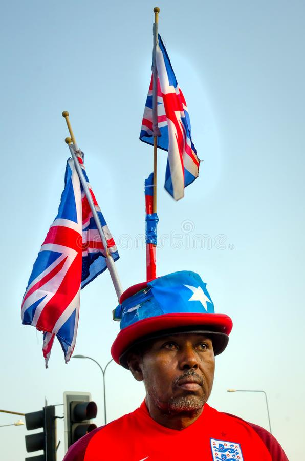 Patriotic Black British man with British Flag at the back royalty free stock photo
