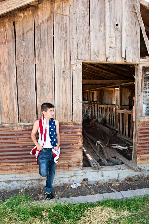 Patriotic Boy And Old Barn Royalty Free Stock Image