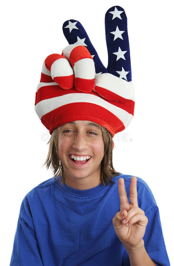 Patriotic Boy - Peace Sign. An immigrant child wearing a USA patriotic hat and giving a peace sign royalty free stock photo