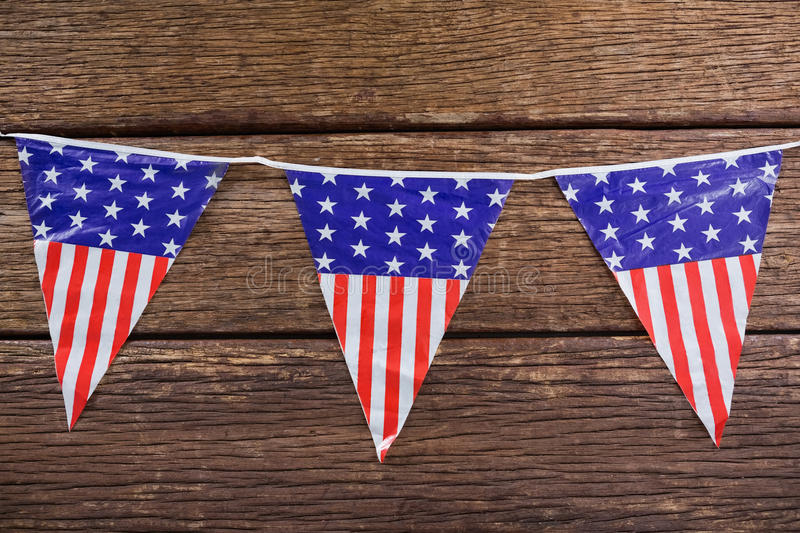 Patriotic bunting arranged on wooden table royalty free stock photography