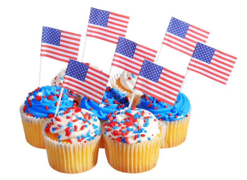 Patriotic cupcakes decorated with American Flags and blue, white cream with red stars sprinkles on the top, isolated. On white background stock photos