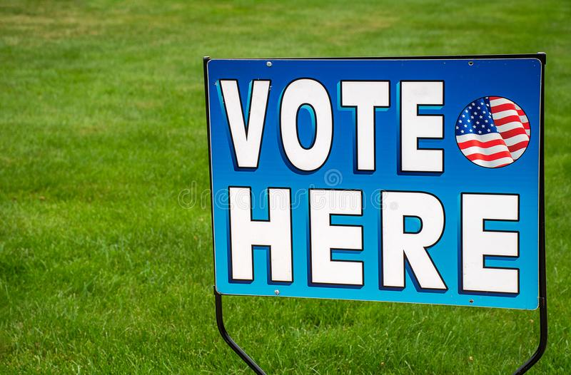 Election voting sign on grass. Patriotic election voting sign on green grass royalty free stock images