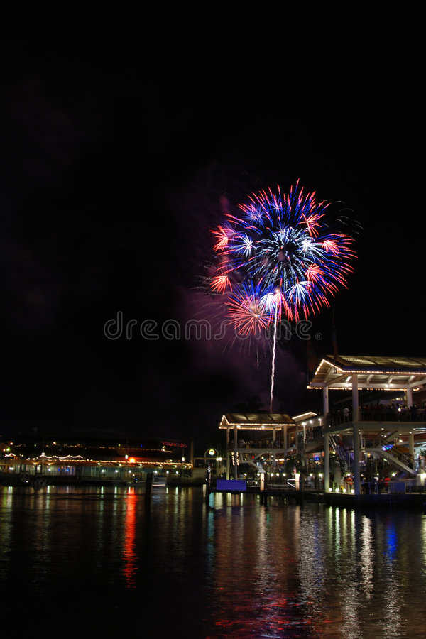 Patriotic Fireworks Over Water in Miami stock photography