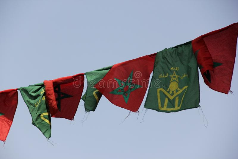 Patriotic Flags. A row of red and green flags decorating a street in Taroudant, Morocco stock photography