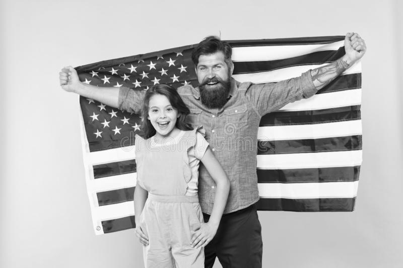 Patriotic fourth of july. Patriotic family celebrating independence day. Bearded man and small child showing patriotic stock image