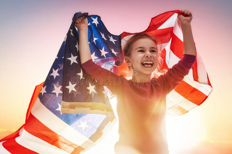 Patriotic holiday and happy kid stock images