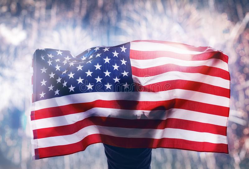 Patriotic holiday. Young man looking at fireworks. royalty free stock images