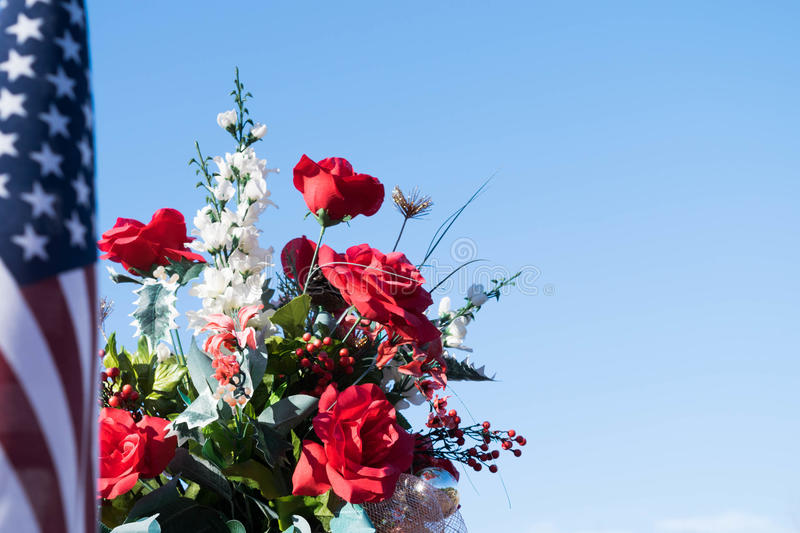 Patriotic image - flowers and American flag royalty free stock photos