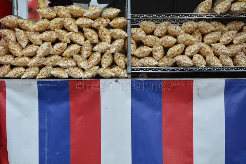 Patriotic Kettle Corn for Sale. These are stacks of kettle corn in a booth with a red, white, and blue banner royalty free stock photos