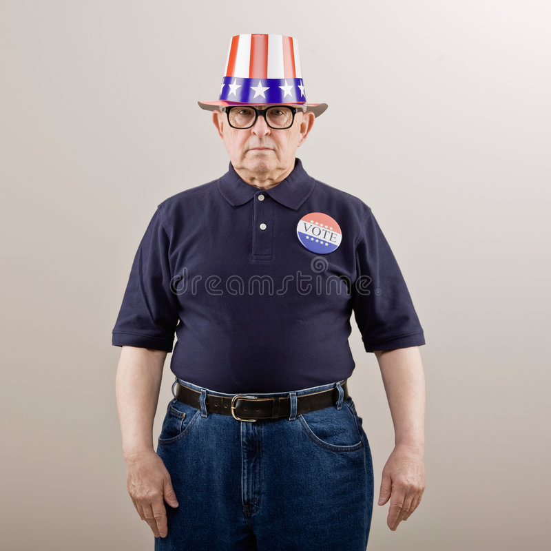 Patriotic man in American flag hat stock photo