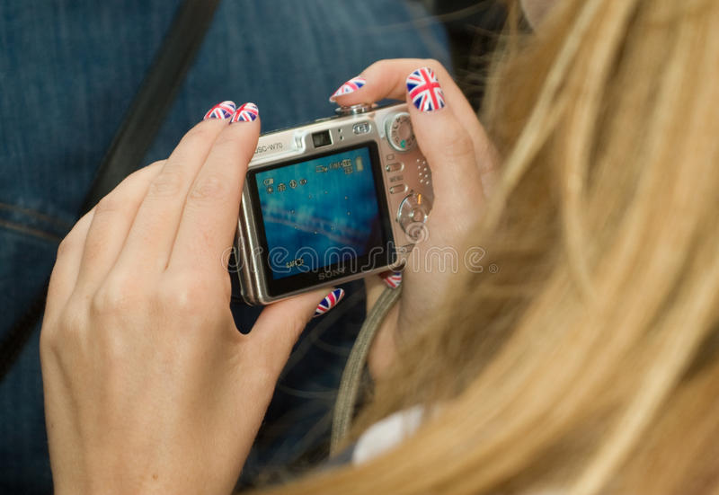 Download Patriotic Olympics Fan Checks Her Photos Editorial Stock Photo - Image: 26038783