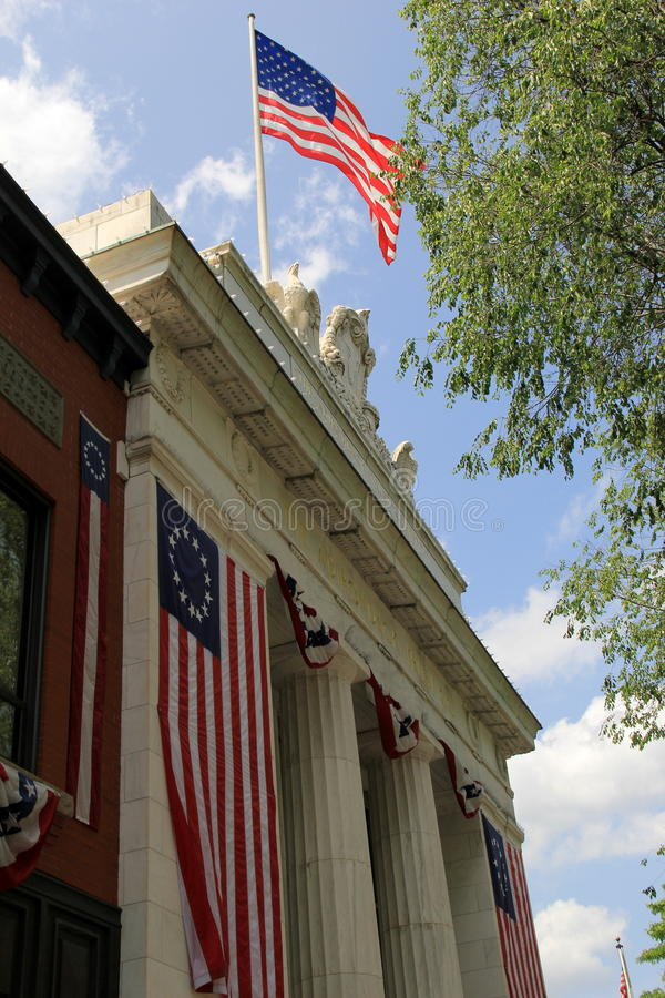 Patriotic shot with large American flags flying from The Adirondack Trust Bank,Saratoga,New York,2015 royalty free stock image