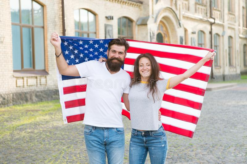 Patriotic spirit. Independence day. National holiday. Bearded hipster and girl celebrating. 4th of July. American royalty free stock photography