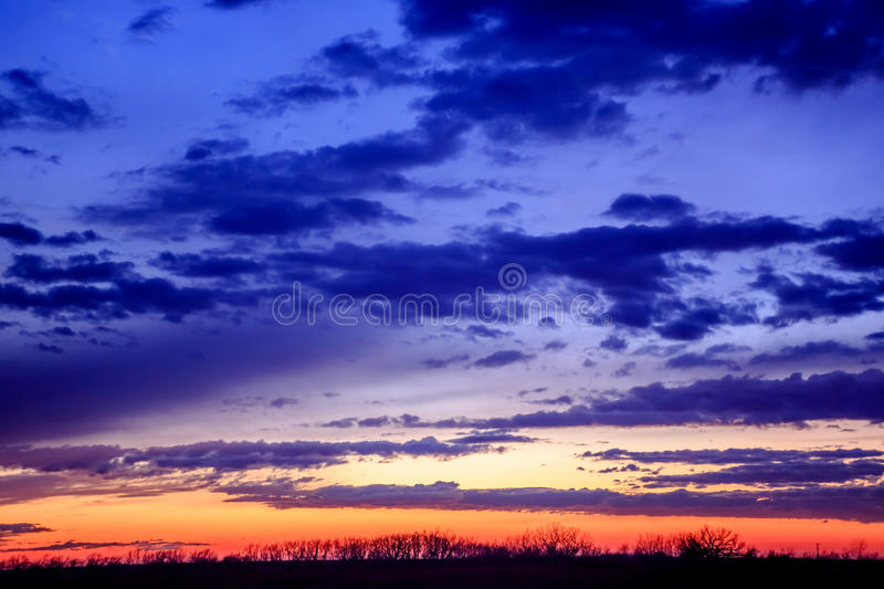 Patriotic Sunset. A horizontal image of a colorful sunset in Kansas that shows the colors of the American flag of red, white, and blue stock photo