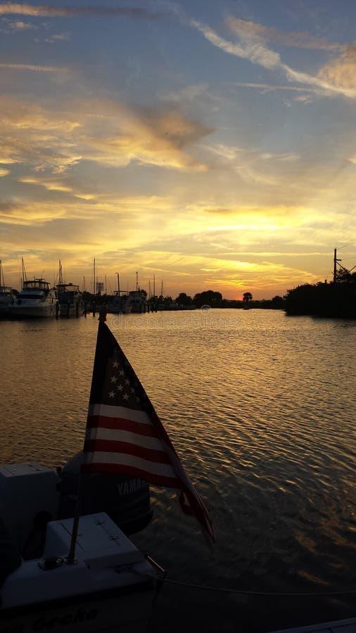 Patriotic sunset. On the marina royalty free stock photo