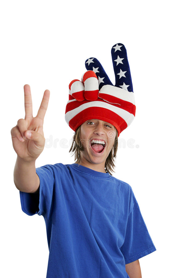 Patriotic Teen - Goofy. A teen boy in a USA patriotic hat giving a peace sign and making a funny face stock photography
