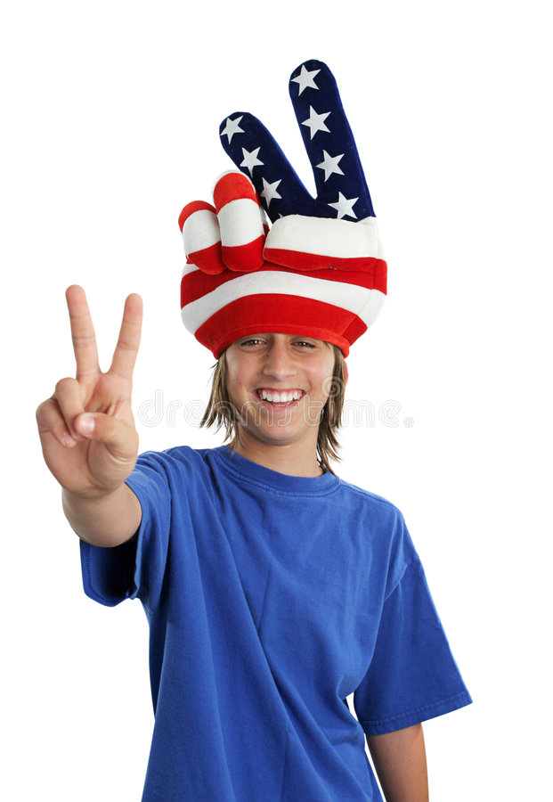 Patriotic Teen - Peace Sign. A patriotic teenager wearing a USA hat and giving a peace sign royalty free stock images