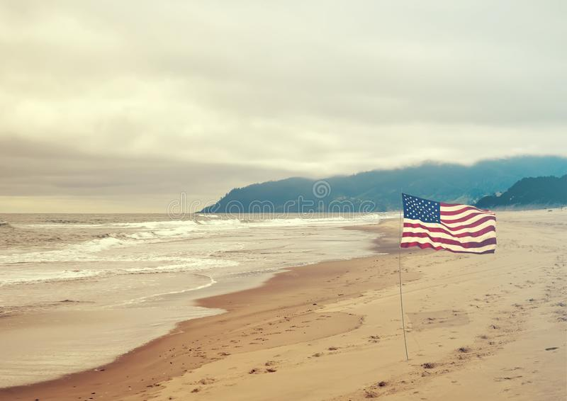 Patriotic USA background with American flag. On the sandy beach stock photos