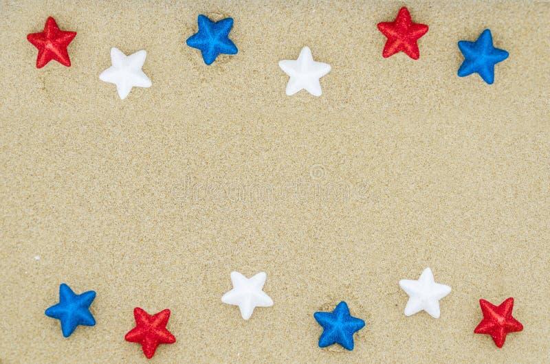 Patriotic USA background on the sandy beach stock image