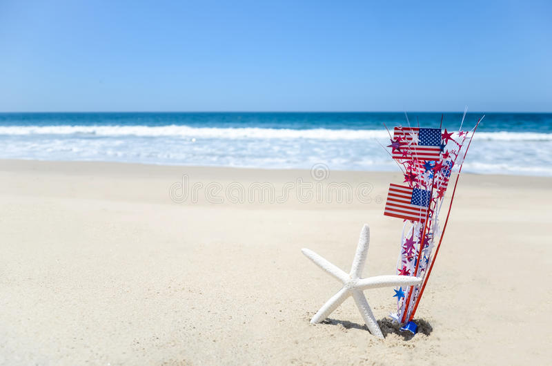 Patriotic USA background with starfish on the sandy beach stock photography