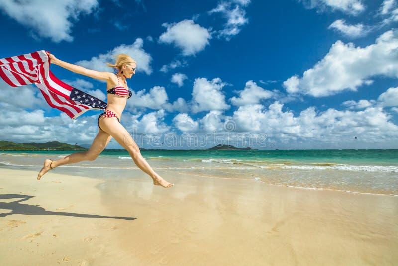 Patriotic woman jumping royalty free stock image