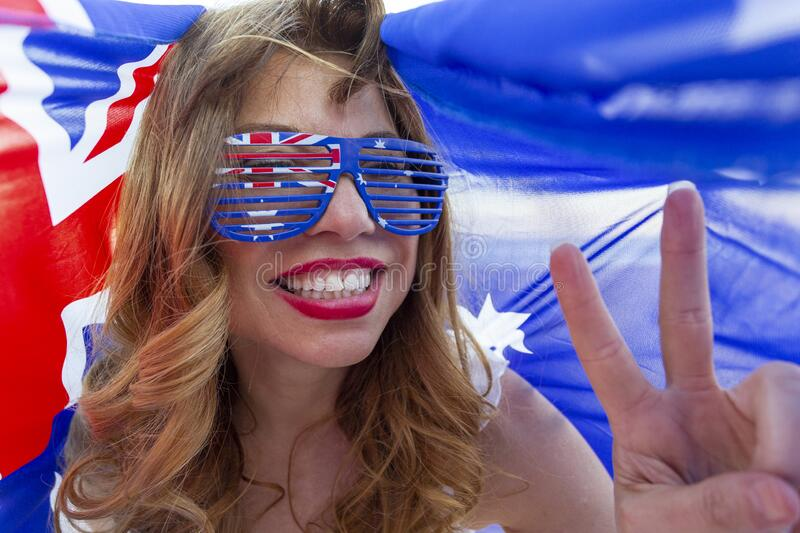 Patriotic woman showing peace sign stock photography