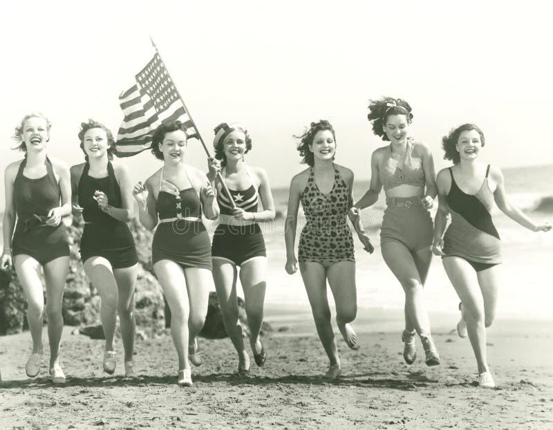 Patriotic women at the beach royalty free stock photo